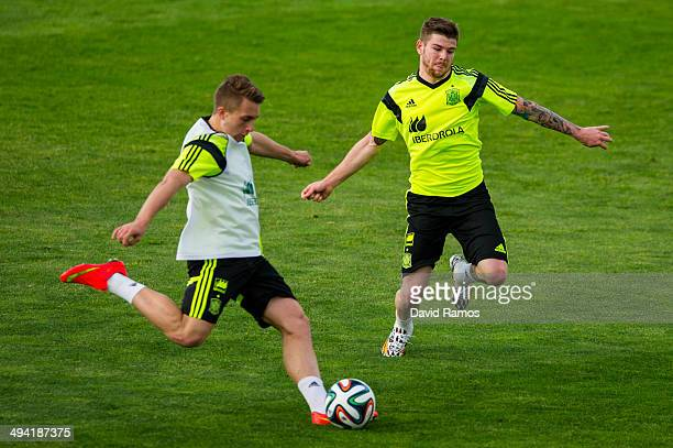 Gerard Deulofeu of Spain duels for the ball with Alberto Moreno of Spain during a training session at Ciudad del Futbol on May 28 2014 in Las Rozas...