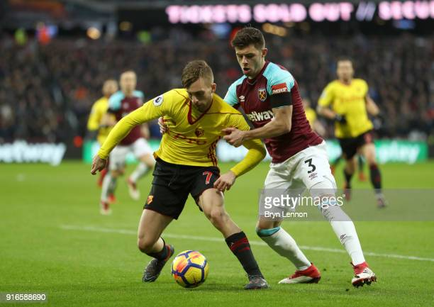 Gerard Deulofeu of Watford and Aaron Cresswell of West Ham United battle for the ball during the Premier League match between West Ham United and...