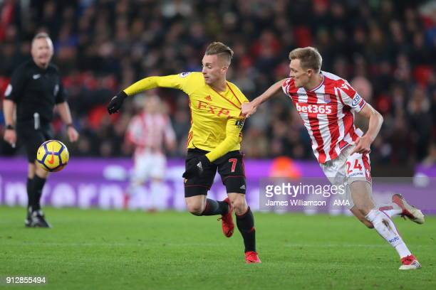 Gerard Deulofeu of Watford and Darren Fletcher of Stoke City during the Premier League match between Stoke City and Watford at Bet365 Stadium on...