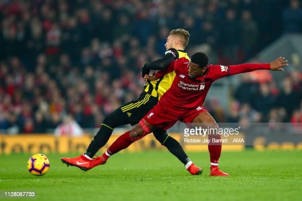 Gerard Deulofeu of Watford and Georginio Wijnaldum of Liverpool during the Premier League match between Liverpool FC and Watford FC at Anfield on...