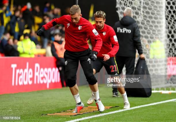 Gerard Deulofeu of Watford and Kiko Femenia of Watford warm up prior to the Premier League match between Watford FC and Huddersfield Town at Vicarage...