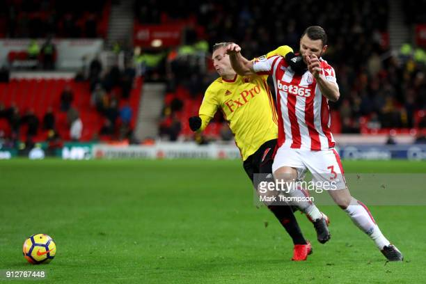 Gerard Deulofeu of Watford battles for possesion with Erik Pieters of Stoke City during the Premier League match between Stoke City and Watford at...