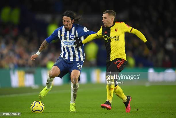 Gerard Deulofeu of Watford battles for possession with Ezequiel Schelotto of Brighton and Hove Albion during the Premier League match between...