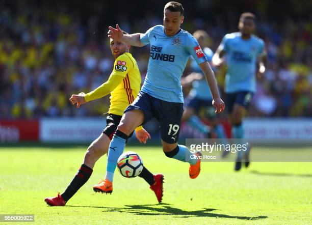 Gerard Deulofeu of Watford battles for possession with Javi Manquillo of Newcastle United during the Premier League match between Watford and...