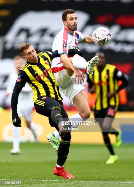 Gerard Deulofeu of Watford battles for possession with Luka Milivojevic of Crystal Palace during the FA Cup Quarter Final match between Watford and...