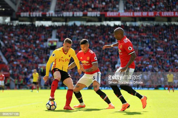 Gerard Deulofeu of Watford battles with Marcos Rojo of Man Utd and Ashley Young of Man Utd during the Premier League match between Manchester United...