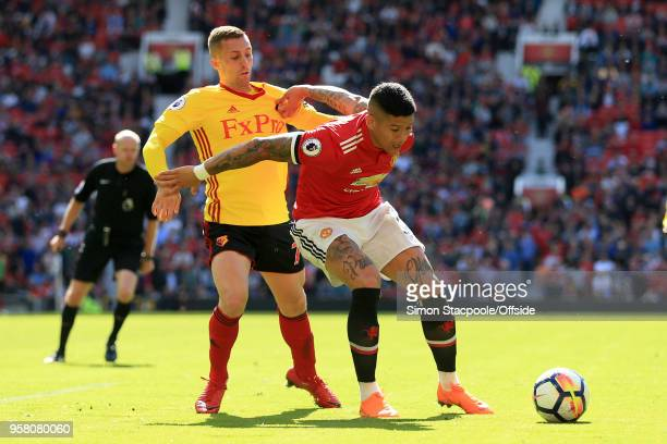 Gerard Deulofeu of Watford battles with Marcos Rojo of Man Utd during the Premier League match between Manchester United and Watford at Old Trafford...