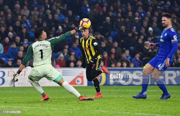 Gerard Deulofeu of Watford beats Neil Etheridge of Cardiff City as he scores his team's thrd goal during the Premier League match between Cardiff...