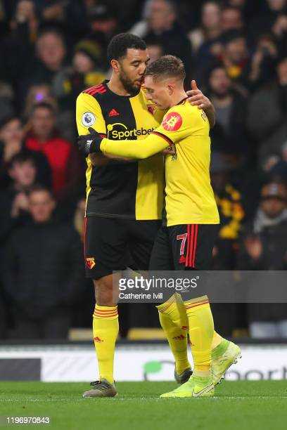 Gerard Deulofeu of Watford celebrates after scoring his sides first goal with teammate Troy Deeney of Watford during the Premier League match between...