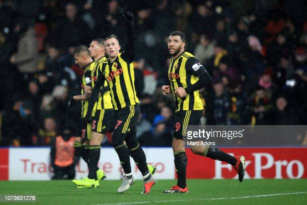 Gerard Deulofeu of Watford celebrates after scoring his team's first goal during the Premier League match between Watford FC and Cardiff City at...