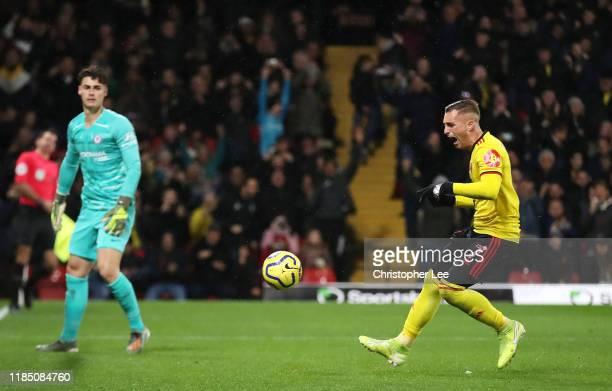 Gerard Deulofeu of Watford celebrates after scoring his team's first goal as Kepa Arrizabalaga of Chelsea reacts during the Premier League match...