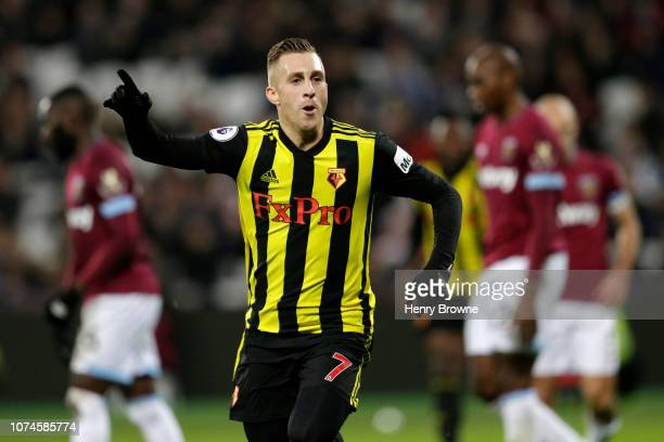 Gerard Deulofeu of Watford celebrates after scoring his team's second goal during the Premier League match between West Ham United and Watford FC at...