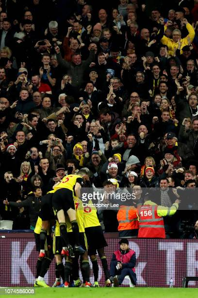 Gerard Deulofeu of Watford celebrates after scoring his team's second goal with his team mates during the Premier League match between West Ham...
