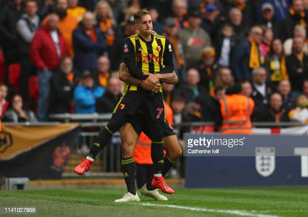 Gerard Deulofeu of Watford celebrates as he scores their third goal with Troy Deeney during the FA Cup Semi Final match between Watford and...