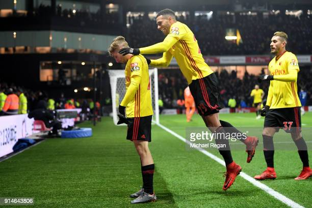 Gerard Deulofeu of Watford celebrates scoring the 3rd Watford goal with Etienne Capoue and Roberto Pereyra during the Premier League match between...