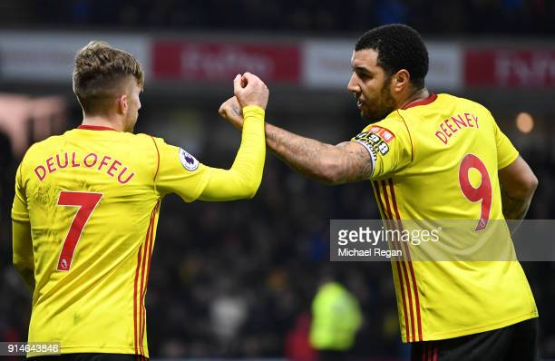 Gerard Deulofeu of Watford celebrates scoring the 3rd Watford goal with Troy Deeney during the Premier League match between Watford and Chelsea at...