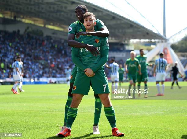 Gerard Deulofeu of Watford celebrates with teammate Abdoulaye Doucoure after scoring his team's first goal during the Premier League match between...