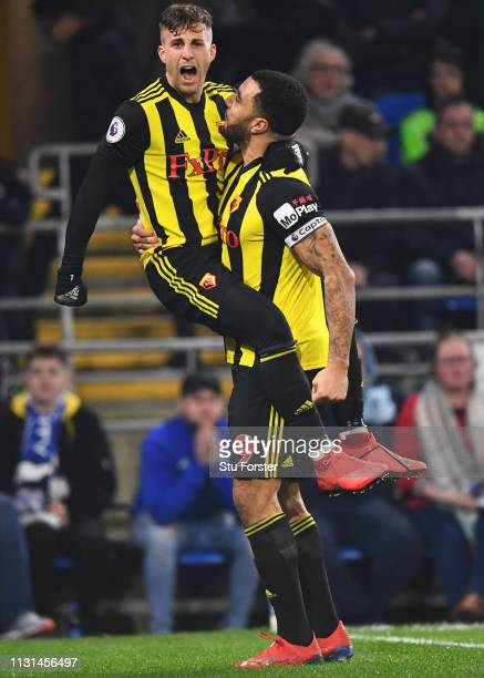 Gerard Deulofeu of Watford celebrates with Troy Deeney as he scores his team's second goal during the Premier League match between Cardiff City and...