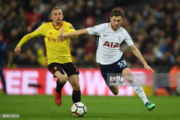 Gerard Deulofeu of Watford challenges Ben Davies of Tottenham Hotspur during the Premier League match between Tottenham Hotspur and Watford at...