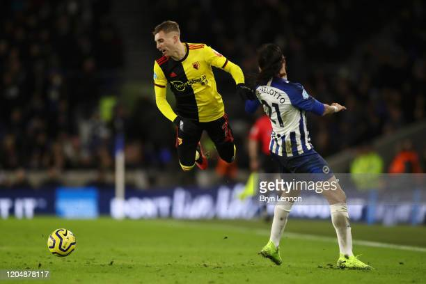 Gerard Deulofeu of Watford clashes with Ezequiel Schelotto of Brighton and Hove Albion during the Premier League match between Brighton Hove Albion...