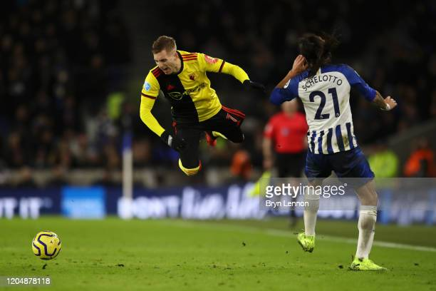 Gerard Deulofeu of Watford clashes with Ezequiel Schelotto of Brighton and Hove Albion during the Premier League match between Brighton & Hove Albion...
