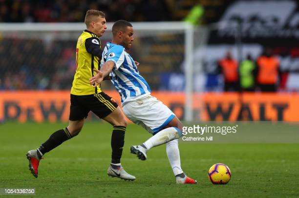 Gerard Deulofeu of Watford competes with Mathias Zanka Jorgensen of Huddersfield Town during the Premier League match between Watford FC and...