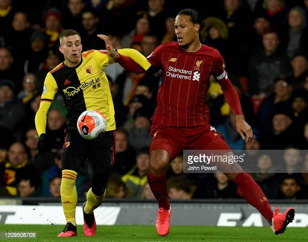 Gerard Deulofeu of Watford competing with Virgil van Dijk of Liverpool during the Premier League match between Watford FC and Liverpool FC at...