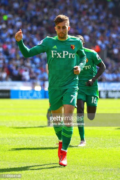 Gerard Deulofeu of Watford FC celebrates scoring the opening goal during the Premier League match between Huddersfield Town and Watford FC at John...
