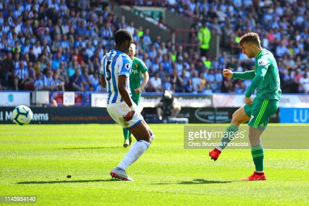 Gerard Deulofeu of Watford FC scores the opening goal during the Premier League match between Huddersfield Town and Watford FC at John Smith's...