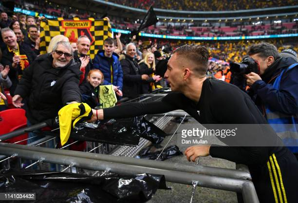 Gerard Deulofeu of Watford hands his shirt to a fan after the FA Cup Semi Final match between Watford and Wolverhampton Wanderers at Wembley Stadium...