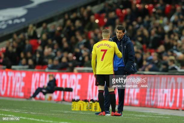 Gerard Deulofeu of Watford in discussion with Watford manager Javi Gracia during the Premier League match between Tottenham Hotspur and Watford at...