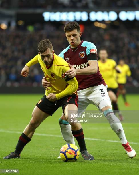 Gerard Deulofeu of Watford is challenged by Aaron Cresswell of West Ham United during the Premier League match between West Ham United and Watford at...