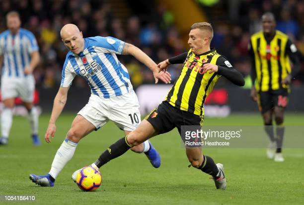 Gerard Deulofeu of Watford is challenged by Aaron Mooy of Huddersfield Town during the Premier League match between Watford FC and Huddersfield Town...