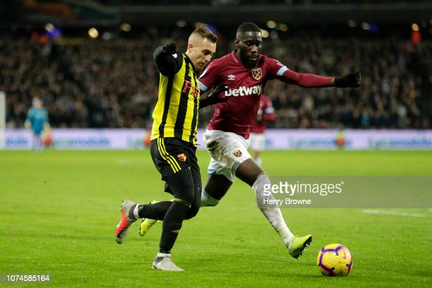 Gerard Deulofeu of Watford is challenged by Arthur Masuaku of West Ham United during the Premier League match between West Ham United and Watford FC...