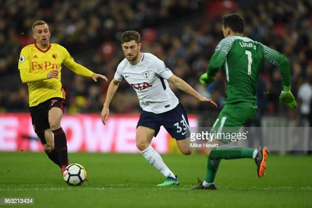 Gerard Deulofeu of Watford is challenged by Ben Davies and Hugo Lloris of Tottenham Hotspur during the Premier League match between Tottenham Hotspur...
