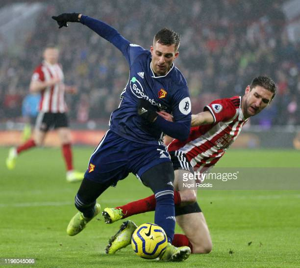 Gerard Deulofeu of Watford is challenged by Chris Basham of Sheffield United during the Premier League match between Sheffield United and Watford FC...