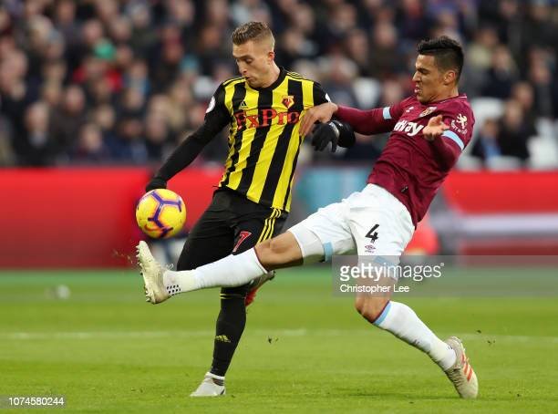 Gerard Deulofeu of Watford is challenged by Fabian Balbuena of West Ham United during the Premier League match between West Ham United and Watford FC...