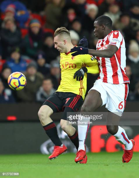 Gerard Deulofeu of Watford is challenged by Kurt Zouma of Stoke City during the Premier League match between Stoke City and Watford at Bet365 Stadium...