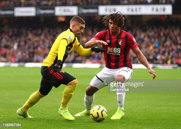 Gerard Deulofeu of Watford is challenged by Nathan Ake of AFC Bournemouth during the Premier League match between Watford FC and AFC Bournemouth at...