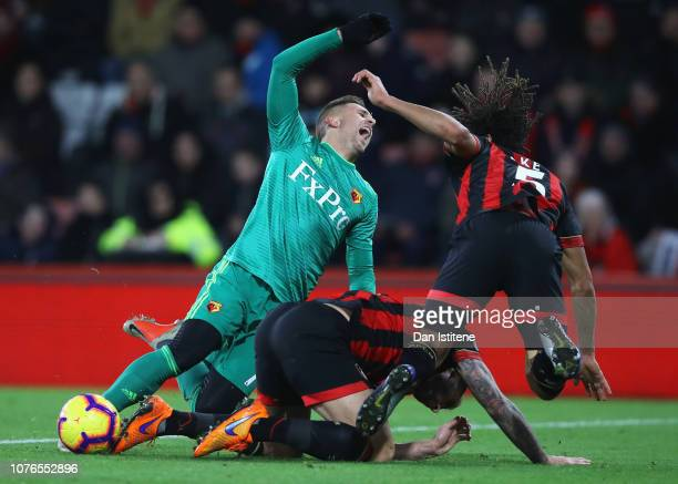 Gerard Deulofeu of Watford is challenged by Steve Cook and Nathan Ake of AFC Bournemouth during the Premier League match between AFC Bournemouth and...