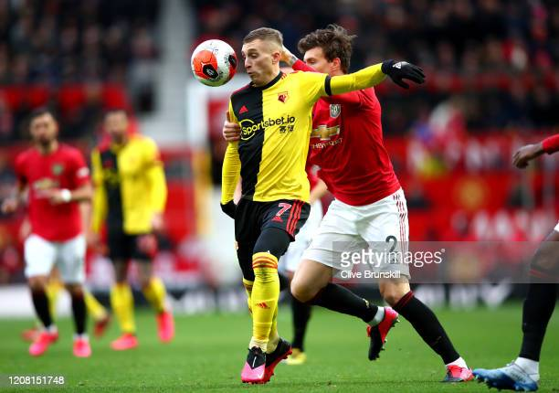 Gerard Deulofeu of Watford is challenged by Victor Lindelof of Manchester United during the Premier League match between Manchester United and...