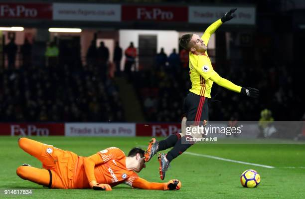 Gerard Deulofeu of Watford is fouled for a penalty kick by Thibaut Courtois of Chelsea during the Premier League match between Watford and Chelsea at...