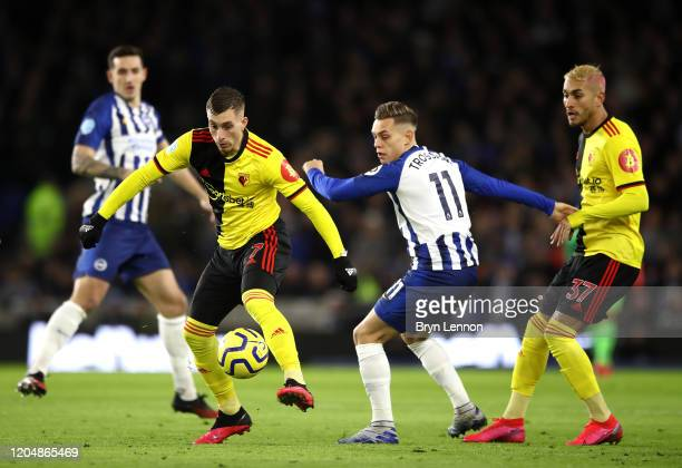 Gerard Deulofeu of Watford is put under pressure by Leondro Trossard of Brighton and Hove Albion during the Premier League match between Brighton...