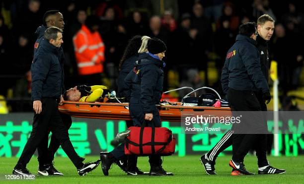 Gerard Deulofeu of Watford is stretchered off with an injury during the Premier League match between Watford FC and Liverpool FC at Vicarage Road on...
