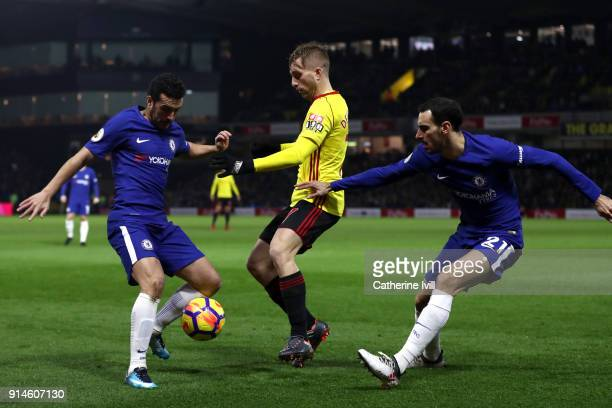 Gerard Deulofeu of Watford is tackled by Pedro and Davide Zappacosta of Chelsea during the Premier League match between Watford and Chelsea at...