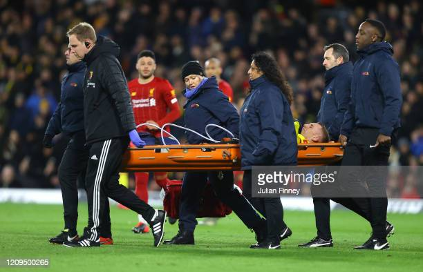 Gerard Deulofeu of Watford leaves the pitch with an injury during the Premier League match between Watford FC and Liverpool FC at Vicarage Road on...