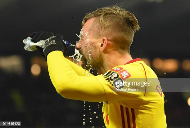 Gerard Deulofeu of Watford pours water on his face during the Premier League match between Watford and Chelsea at Vicarage Road on February 5 2018 in...
