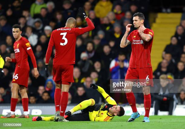 Gerard Deulofeu of Watford reacts with an injury during the Premier League match between Watford FC and Liverpool FC at Vicarage Road on February 29...