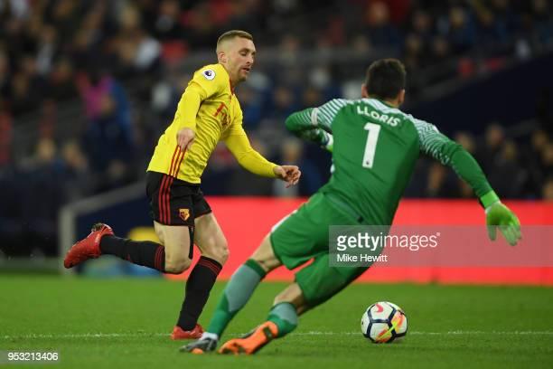 Gerard Deulofeu of Watford rounds Hugo Lloris of Tottenham Hotspur to score but is offside during the Premier League match between Tottenham Hotspur...