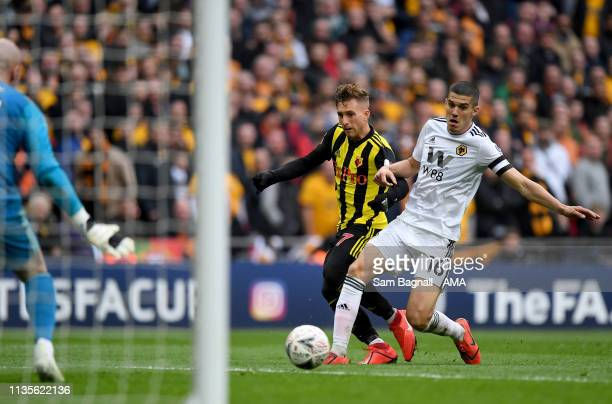 Gerard Deulofeu of Watford scores a goal to make it 3-2 as Conor Coady of Wolverhampton Wanderers looks onduring the FA Cup Semi Final match between...